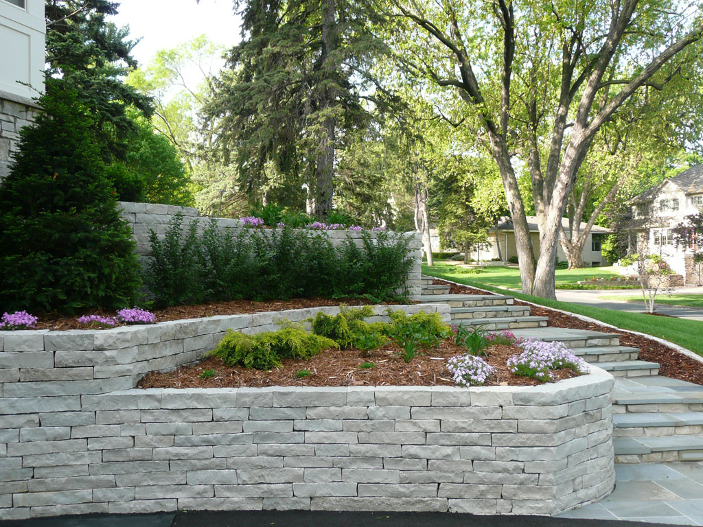 Mr adam residential landscape design your own yard flags for Block wall landscape design